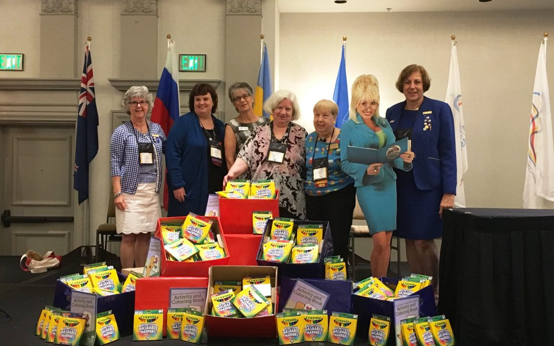 Altrusa International Colors GBBF Happy with Crayola Markers Donation